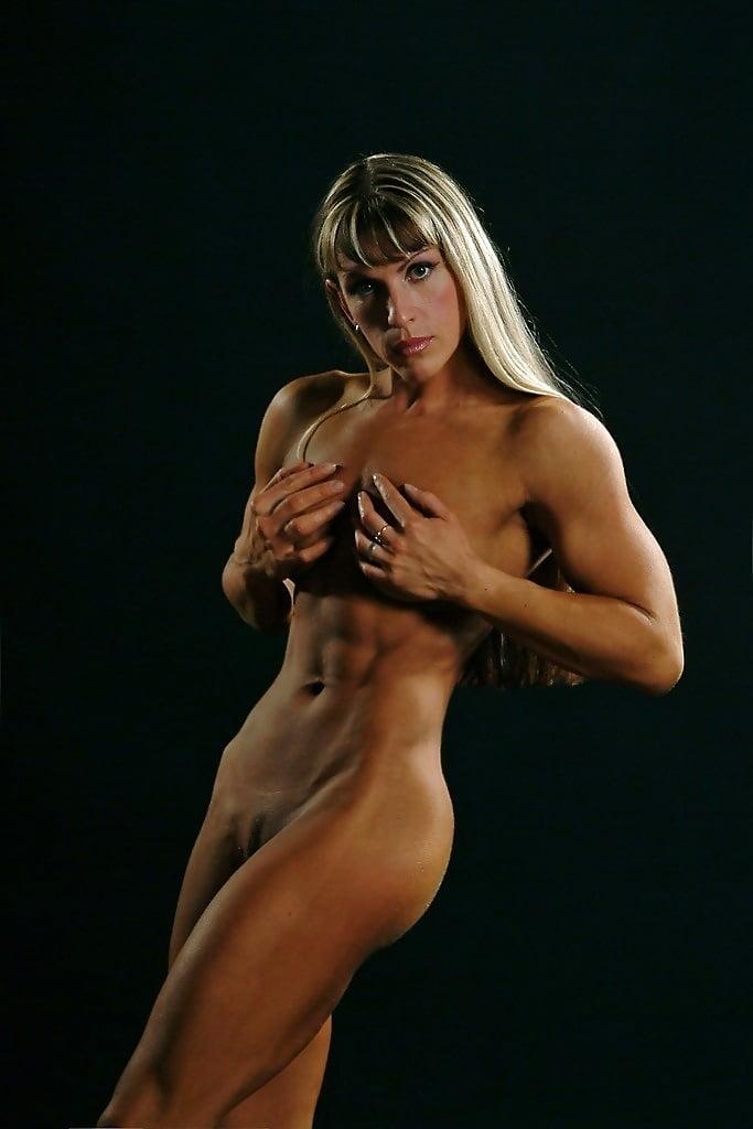 Handsome nude muscular bodybuilder stock image