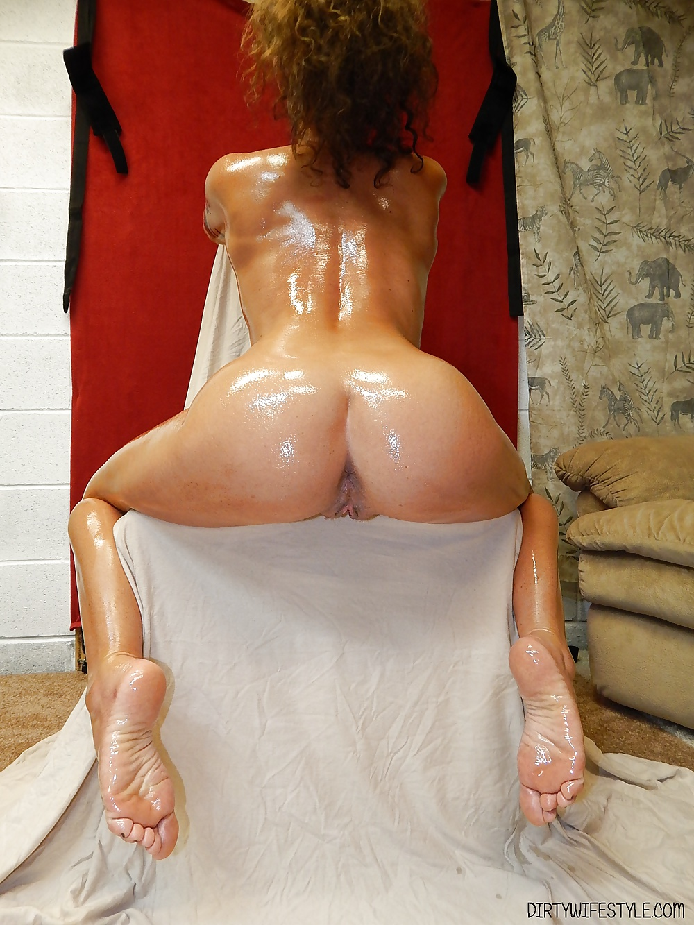 Naked oiled butts