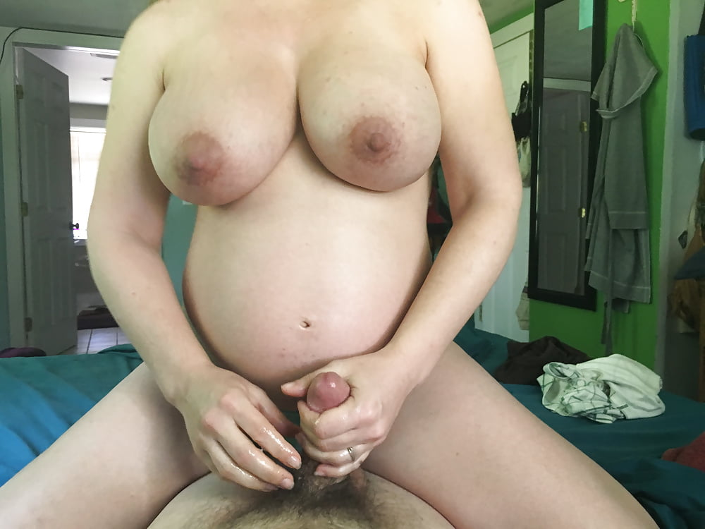 Pregnant Girl Gives A Handjob And He Cums Hard