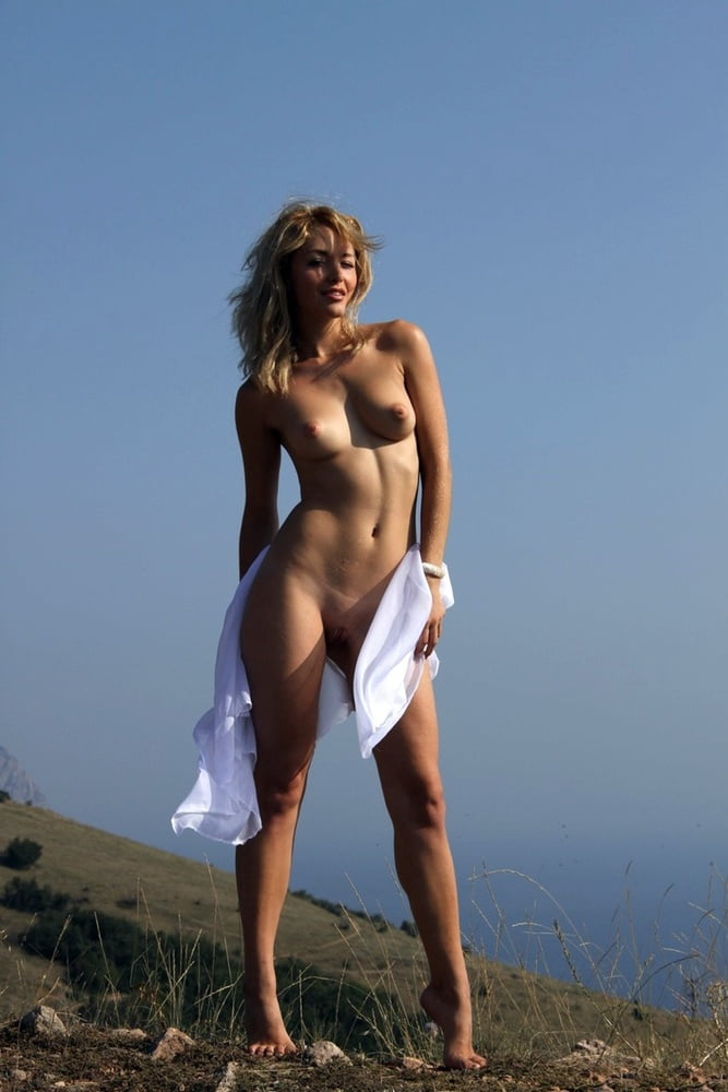 Barefoot Blonde Girl Alisa Stands Naked Atop Cliff Overlooking Erosberry 1